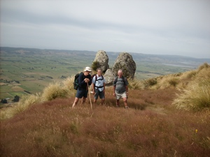 Twin rocks. Taieri Plain from Kempshall Rd Track. George, Glenice, Doug (Hazel pic)