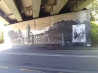 Clock tower mural under bridge. (Bruce pic and caption)